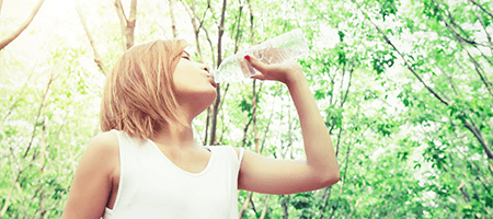 A woman preventing dehydration during pregnancy