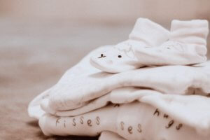 pile of clothes for a baby registry